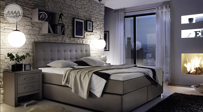 Wysokie łóżko Boxspring w modnej i stylowej sypialni