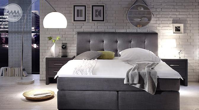 Modne łóżko Boxspring w komfortowej sypialni